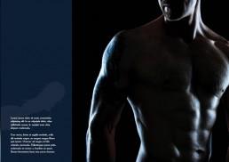 Overkrop af mand uden trøje som viser hans mavemuskler